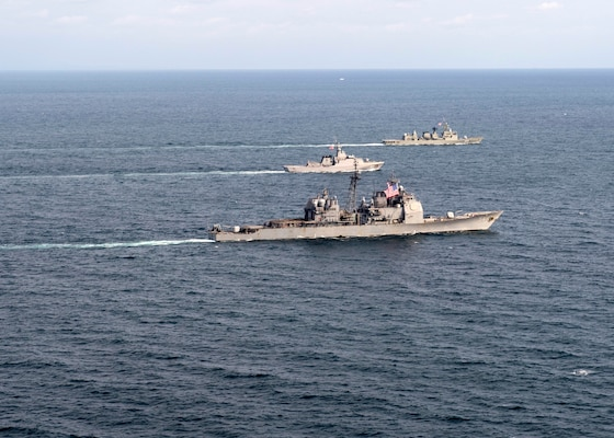 EAST CHINA SEA (Oct. 9, 2018) The Ticonderoga-class guided-missile cruiser USS Antietam (CG 54), the Royal Thai Navy offshore patrol vessel HTMS Krabi (OPV 551) and Royal Thai Navy frigate HTMS Taksin (FFG 422) conduct a tactical maneuvering during a cooperative deployment. Antietam is forward deployed to the U.S. 7th Fleet area of operations in support of security and stability in the Indo-Pacific region.