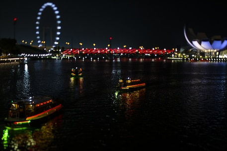 "River boats navigate the Singapore River, Oct. 4, 2018. Marines and Sailors with the 31st Marine Expeditionary Unit arrived in the ""Lion City"" aboard the amphibious assault ship USS Wasp (LHD 1) October 2 for a port visit after more than a month at sea during a regularly-scheduled patrol of the Indo-Pacific region."