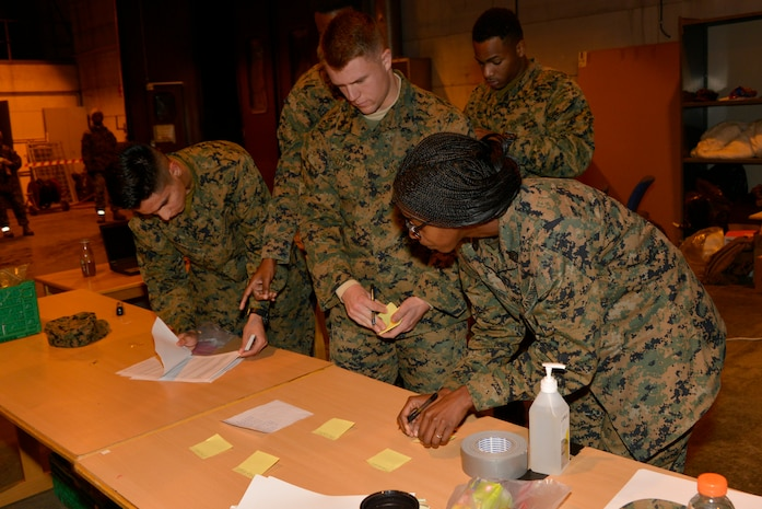 Marines verify rosters to ensure approximately 300 Marines from units all across II Marine Expeditionary Force are accounted for after their arrival at Vaernes Air Station, Norway, from Camp Lejeune, N.C., on Oct. 3, 2018, in order to participate in Exercise Trident Juncture 2018. Trident Juncture 18 enhances the U.S. and NATO Allies' abilities to work together collectively to conduct military operations under challenging conditions. (U.S. Marine Corps photo by GySgt. Rebekka S. Heite)