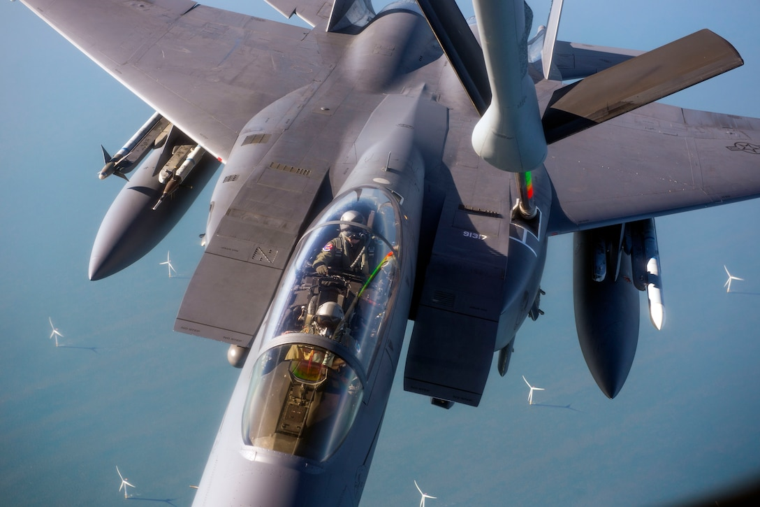 A U.S. Air Force F-15E Strike Eagle assigned to RAF Lakenheath, England, takes on fuel from a U.S. Air Force KC-135 Stratotanker assigned to RAF Mildenhall, England, off the coast of England, Oct. 10, 2018. RAF Lakenheath hosted a large forces exercise that included F-22 Raptors from Joint Base Langley-Eustis, Va., F-15E Strike Eagles from RAF Lakenheath and F/A-18 Super Hornets from the Carrier Air Wing from USS Harry S. Truman (CVN-75). (U.S. Air Force photo by Staff Sgt. Christine Groening)