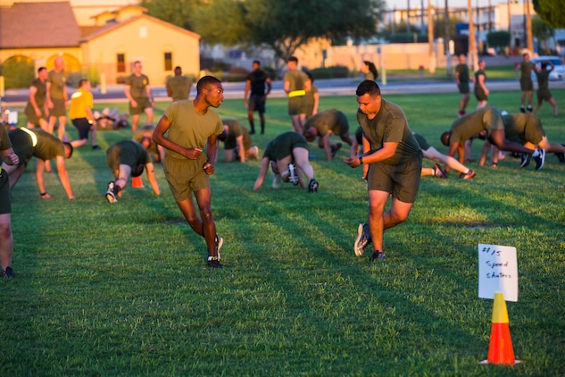 Marines, Sailors, and civilians aboard Marine Corps Air Station (MCAS) Yuma participate in High Intensity Tactical Training (HITT) on the Lawn, at the parade deck on MCAS Yuma, Ariz., Sept. 28, 2018. HITT on the Lawn is a physical training event that is open to anyone with base access and provides them with a physical training opportunity. (U.S. Marine Corps photo taken by Cpl. Isaac D. Martinez)
