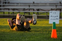 """Lance Cpl. Joel Soriano, a combat photographer assigned to Headquarters and Headquarters Squadron (H&HS), performs """"bicycle kicks"""" during High Intensity Tactical Training (HITT) on the Lawn, at the parade deck on Marine Corps Air Station Yuma, Ariz., Sept. 28, 2018. HITT on the Lawn is a physical training event that is open to anyone with base access and provides them with a physical training opportunity. (U.S. Marine Corps photo taken by Cpl. Isaac D. Martinez)"""