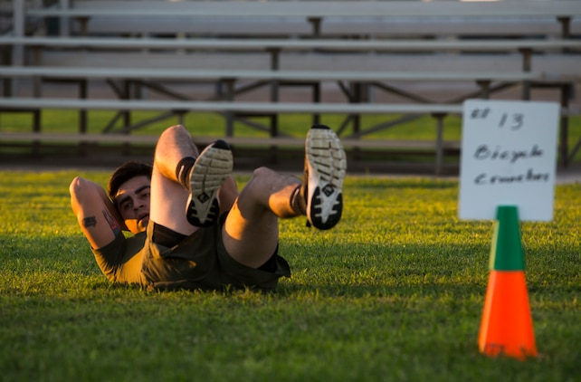 "Lance Cpl. Joel Soriano, a combat photographer assigned to Headquarters and Headquarters Squadron (H&HS), performs ""bicycle kicks"" during High Intensity Tactical Training (HITT) on the Lawn, at the parade deck on Marine Corps Air Station Yuma, Ariz., Sept. 28, 2018. HITT on the Lawn is a physical training event that is open to anyone with base access and provides them with a physical training opportunity. (U.S. Marine Corps photo taken by Cpl. Isaac D. Martinez)"