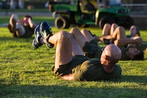 """Col. David A. Suggs, the commanding officer of Marine Corps Air Station (MCAS) Yuma, performs """"bicycle kicks"""" during High Intensity Tactical Training (HITT) on the Lawn, at the parade deck on Marine Corps Air Station Yuma, Ariz., Sept. 28, 2018. HITT on the Lawn is a physical training event that is open to anyone with base access and provides them with a physical training opportunity. (U.S. Marine Corps photo taken by Cpl. Isaac D. Martinez)"""