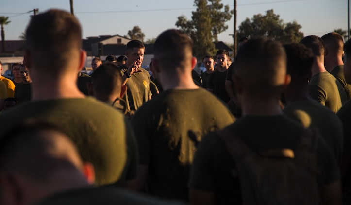 Lt. Col. James C. Paxton III, the commanding officer of Headquarters and Headquarters Squadron (H&HS), speaks to a group of Marines assigned to H&HS about the importance of physical training, just after the completion of High Intensity Tactical Training (HITT) on the Lawn, at the parade deck on Marine Corps Air Station Yuma, Ariz., Sept. 28, 2018. HITT on the Lawn is a physical training event that is open to anyone with base access and provides them with a physical training opportunity. (U.S. Marine Corps photo taken by Cpl. Isaac D. Martinez)