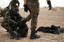 U.S. Marines stationed at Marine Corps Air Station (MCAS) Yuma, conduct their annual Chemical, Biological, Radiological and Nuclear Defense (CBRN) Training at the MCAS Yuma Gas Chamber July 26, 2018. The gas chamber is a controlled environment in which a non-lethal gas is released. This trains Marines to have confidence in their gear and become familiar with the effects of gas. (U.S. Marine Corps Photos by Lance Cpl. Sabrina Candiaflores)