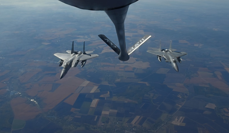 Two U.S. Air Force F-15C Eagles from the 144th Fighter Wing, Fresno Air National Guard Base, Calif., fly behind a U.S. Air Force KC-135 Stratotanker from RAF Mildenhall, England, after receiving fuel during Exercise Clear Sky over Romania, Oct. 10, 2018. The exercise is a joint and multinational exercise that involved approximately 950 personnel from nine nations. (U.S. Air Force photo by Senior Airman Luke Milano)