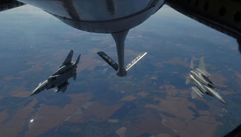 Two U.S. Air Force F-15C Eagles from the 144th Fighter Wing, Fresno Air National Guard Base, Calif., break away behind a KC-135 Stratotanker from RAF Mildenhall, England, after receiving fuel during Exercise Clear Sky over Romania, Oct. 10, 2018. The exercise is a joint and multinational exercise that involved approximately 950 personnel from nine nations. (U.S. Air Force photo by Senior Airman Luke Milano)