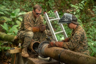 U.S. Marines assess the repair process on a broken water valve in Trujillo, Honduras, Sept. 22, 2018.