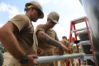 U.S. Navy Seabees mark the location of a plumbing fixture in Riohacha, Colombia, Sept. 27, 2018,