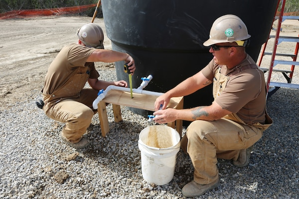 U.S. Navy Seabees take a measurement in Riohacha, Colombia, Sept. 27, 2018, during water-well drilling exploration operations as part of Southern Partnership Station 2018