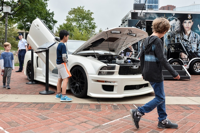 Local Maryland children inspect the Ford Mustang (X-1) during Fleet Week October 6, 2018 in Baltimore, Maryland. The X-1 is part of an Air Force Recruiting Service 2009 Super Car Tour recruiting initiative that kicked off in May of 2009. (U.S. Air Force photo by Staff Sgt. Alexandre Montes)