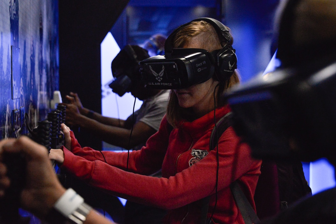 Local residents and visitors test out the Air Force Recruiting Services Special Operations Virtual Reality scenarios during Fleet Week October 6, 2018 in Baltimore, Maryland. Fleet Week Baltimore gave Maryland residents a chance to meet and learn about U.S. maritime capabilities of the U.S. Navy and Marine Corps, along with promoting community growth and interaction with all services. (U.S. Air Force photo by Staff Sgt. Alexandre Montes)