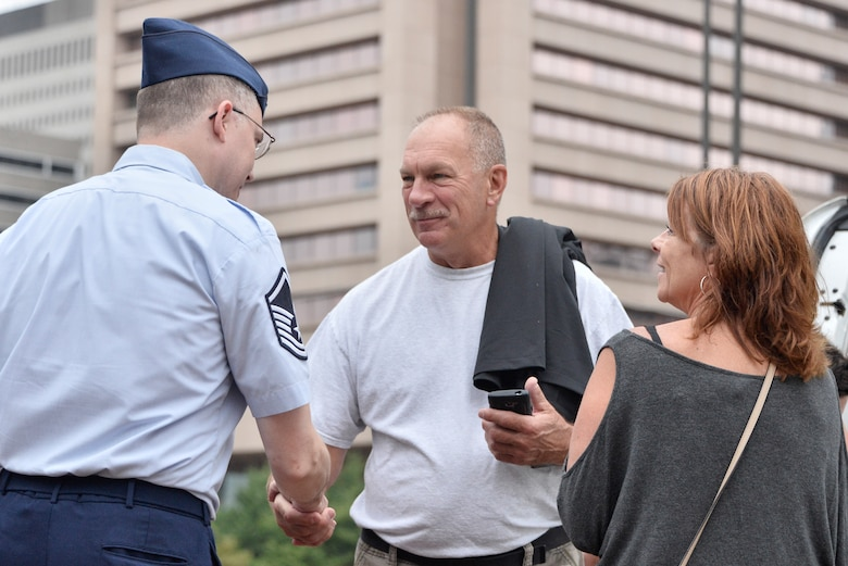 Master Sgt. Marshall Hackett, 70th Operations Support Squadron chief military language instructor, is thanked by local Maryland residents during Fleet Week October 6, 2018 in Baltimore, Maryland. Fleet Week Baltimore gave Maryland residents a chance to meet and learn about U.S. maritime capabilities of the U.S. Navy and Marine Corps, along with promoting community growth and interaction with all services. (U.S. Air Force photo by Staff Sgt. Alexandre Montes)