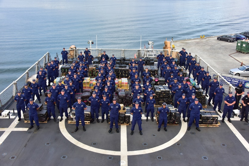 The crew of the Coast Guard Cutter Stratton poses with more than 11 tons of cocaine .