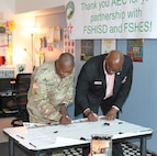 Col. Isaac Manigault (left), commander of the U.S. Army Environmental Command, and Dr. Gary Bates, Fort Sam Houston Independent School District superintendent,officially sign the partnership agreement Oct. 3, kicking off the command's participation in and support of elementary school activities for the next two years.
