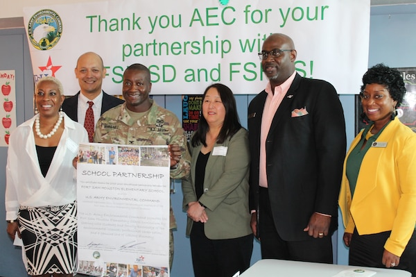 Leaders from the U.S. Army Environmental Command and Fort Sam Houston Independent School District signed a charter and agreement in a Fort Sam Houston Elementary School fifth-grade classroom Oct. 3 to continue their Adopt-A-School Program partnership, which began in 2011.