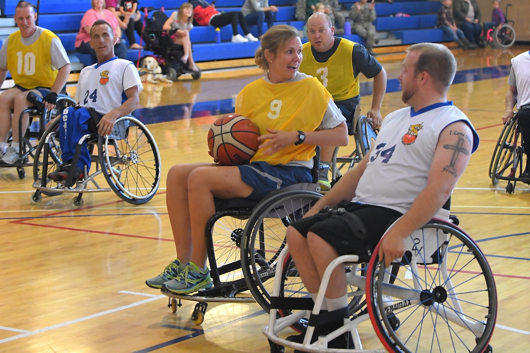 Col. Regina Sabric, 419th Fighter Wing commander, during a wheelchair basketball game Oct. 3, 2018, at Hill Air Force Base, Utah. Leadership from units across the base faced off against Ogden's Wheelin' Wildcarts, a semi-professional wheelchair basketball team, to celebrate Disability Awareness Month. (U.S. Air Force photo by Todd Cromar)