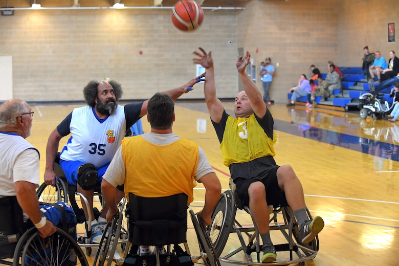 Players scramble for possession of the ball during a wheelchair basketball game Oct. 3, 2018, at Hill Air Force Base, Utah. Leadership from units across the base faced off against Ogden's Wheelin' Wildcarts, a semi-professional wheelchair basketball team, to celebrate Disability Awareness Month. (U.S. Air Force photo by Todd Cromar)