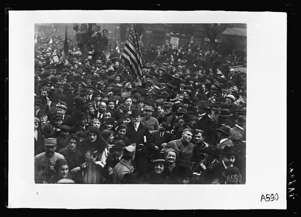 American Doughboys surrounded by French civilian celebrate the Armistice in Paris.