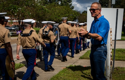 Maj. Gen. Burke W. Whitman, commander of Marine Forces Reserve and Marine Forces North, gives a round of applause to the MARFORRES Band during the Algiers Festival 2018 in Federal City, New Orleans, Oct. 6, 2018. The band performed to show their support towards the New Orleans community and kicked off the Algiers Festival 2018. (U.S. Marine Corps photo by Cpl, Andy O. Martinez)