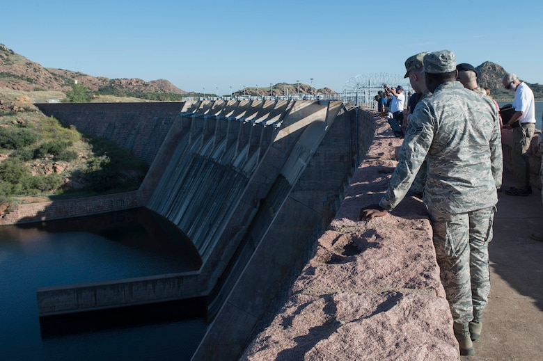 Members of the 97th Air Mobility Wing look at the Lake Altus-Lugert outflow, during the tour of the dam, Oct. 5, 2018, in Lugert, Okla.