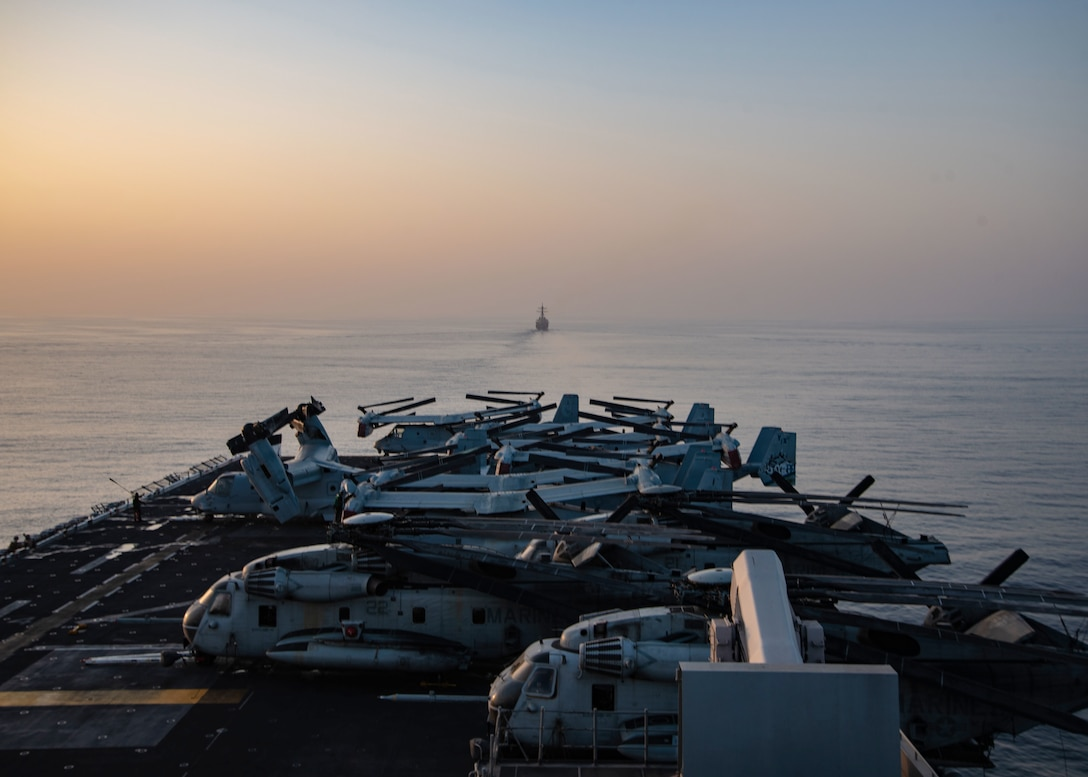 STRAIT OF HORMUZ (Oct. 10, 2018) Arleigh Burke-class guided-missile destroyer USS The Sullivans (DDG 68) transits the Strait of Hormuz in formation with Wasp-class amphibious assault ship USS Essex (LHD 2) during a regularly scheduled deployment of Essex Amphibious Ready Group and 13th Marine Expeditionary Unit. USS Essex is a lethal, flexible, and persistent Navy-Marine Corps team deployed to the U.S. 5th Fleet area of operation in support of naval operations to ensure maritime stability and security in the Central Region, connecting the Mediterranean and the Pacific through the western Indian Ocean and three strategic choke points. (U.S. Navy photo by Mass Communication Specialist 3rd Class Jenna Dobson/Released)