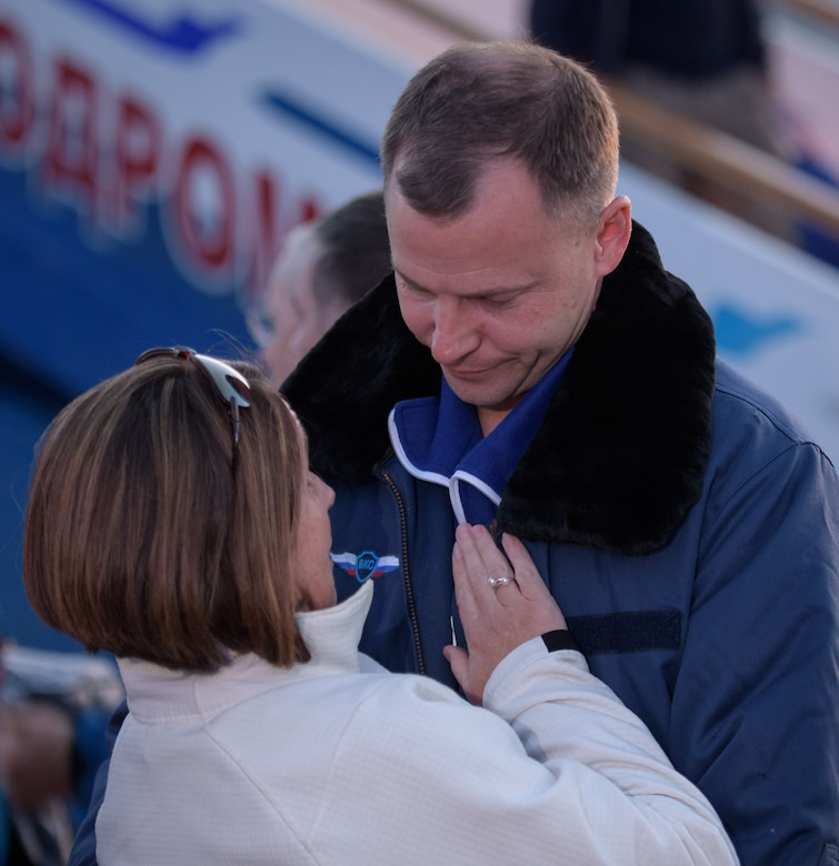 Air Force Col. Nick Hague of NASA embraces his wife, Air Force Lt. Col. Catie Hague, after landing at the Krayniy Airport in Baikonur, Kazakhstan.