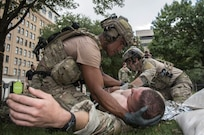 Pararescuemen perform battlefield trauma skills during the PJ Rodeo Sept. 19, 2018, at Travis Park in San Antonio, Texas. The PJ Rodeo is a friendly, but tough competition, tailored to test the skills, tactics, techniques and procedures employed by today's USAF Pararescuemen. Every two years, active duty, Air Force Reserve, Air Force Guard, and retired PJs gather to honor the legacy of USAF Pararescue, and to remember and celebrate teammates who gave all.
