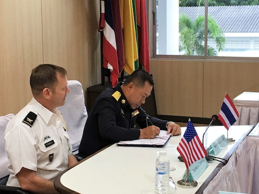 Royal Thailand Air Force Air Marshal Yuttachai Watcharasing (right) signs an agreement for space situational awareness services and data as U.S. Army Col. Wayne Turnbull, senior defense official and defense attaché to Thailand, witnesses the signing, Oct. 1, 2018, in Thailand. Agreements like these bolsters the United States and Thailand's awareness in the space domain. (Courtesy Photo)