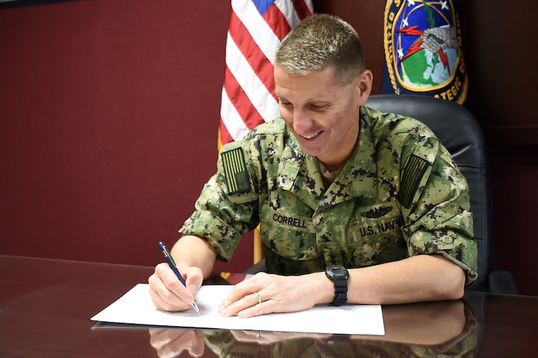 U.S. Navy Rear Adm. Richard Correll, U.S. Strategic Command (USSTRATCOM) director of plans and policy, signs an agreement to share space situational awareness services and information with Thailand at USSTRATCOM headquarters on Offutt Air Force Base, Neb, Oct. 11, 2018. Agreements like these lay the foundation that allows the United States to share information with allies and partners. (U.S. Air Force photo by Master Sgt. April Wickes)