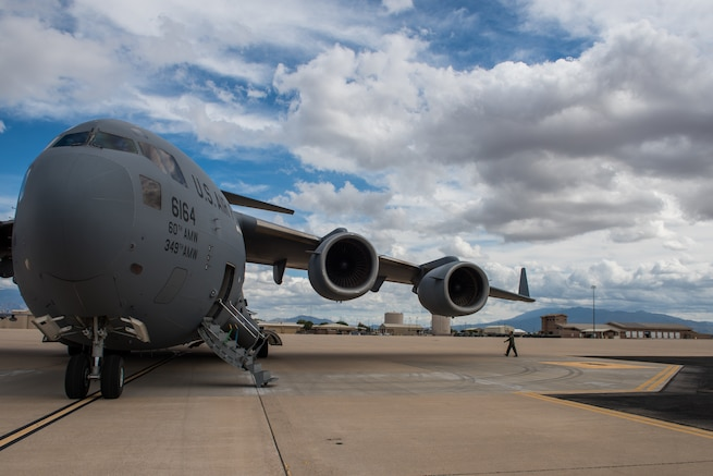U.S. Air Force Maj. Nathan Masdon, 21st Airlift Squadron C-17 Globemaster III pilot, completes a walk around inspection of a C-17 at Davis-Monthan Air Force Base, Arizona, Oct. 11, 2018. The aircraft and crew departed Travis Air Force Base Oct. 10, 2018, and were staged at Davis-Monthan to support civil authorities during Hurricane Michael relief efforts. (U.S. Air Force Photo by Master Sgt. Joseph Swafford)