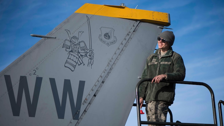 U.S. Air Force Senior Airman Cody Fugate, a 13th Aircraft Maintenance Unit crew chief, smiles while on top of an F-16 Fighting Falcon during exercise Red Flag-Alaska 19-1, at Eielson Air Force Base, Alaska, Oct. 9, 2018. Fugate is responsible for launching recovery jets and performing routine maintenance such as tire inspections, damaged parts repair and administering hydraulic oil to the jet. (U.S. Air Force photo by Airman 1st Class Collette Brooks)