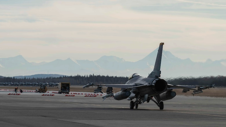 A U.S. Air Force F-16 Fighting Falcon taxis down the runway during exercise Red Flag-Alaska 19-1, at Eielson Air Force Base, Alaska, Oct. 9, 2018. During the exercise, Team Misawa maintainers worked diligently to inspect and repair multiple jets prior to take-off enhancing pilot safety. (U.S. Air Force photo by Airman 1st Class Collette Brooks)