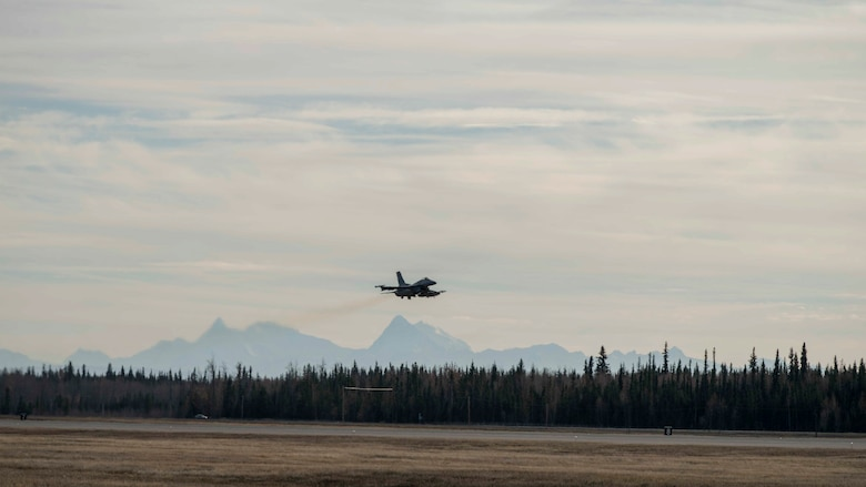 A U.S. Air Force F-16 Fighting Falcon takes flight during exercise Red Flag-Alaska 19-1, at Eielson Air Force Base, Alaska, Oct. 9, 2018. During the exercise, Misawa Air Base maintainers work diligently to inspect and repair multiple jets prior to take-off in order to enhance pilot safety. (U.S. Air Force photo by Airman 1st Class Collette Brooks)