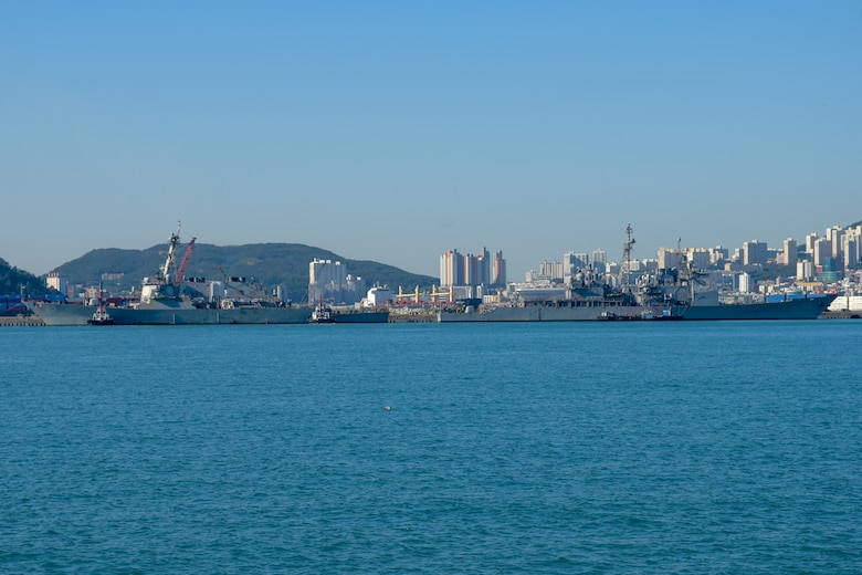 BUSAN, Republic of Korea (Oct. 12, 2018) Arleigh Burke-class guided-missile destroyer USS Benfold (DDG 65) and Ticonderoga-class guided-missile cruiser USS Chancellorsville (CG 62)arrives in Commander, Republic of Korea Fleet base pier as part of a regularly scheduled port visit. Benfold and Chancellorsville are underway with the USS Ronald Reagan (CVN 76) Carrier Strike Group and are forward deployed to the U.S. 7th Fleet area of operations in support of security and stability in the Into-Pacific region.