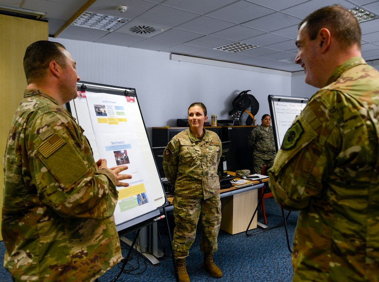 U.S. Air Force Brig. Gen. Mark R. August, 86th Airlift Wing commander, listens to a brief given by 86th Maintenance Group Airmen on Ramstein Air Base, Germany, Oct. 9, 2018. During the brief, August and Chief Master Sgt. Ernesto J. Rendon Jr., 86th AW command chief, learned about many of the training and continuous process improvement initiatives the 86th MXG has in place, some of which have been designated as processes other units around the Air Force should implement. (U.S. Air Force photo by Staff Sgt. Timothy Moore)