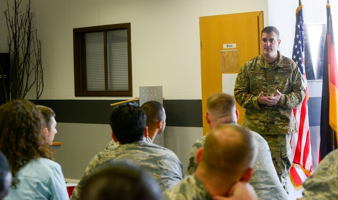 U.S. Air Force Brig. Gen. Mark R. August, 86th Airlift Wing commander, answers questions during an immersion tour of the 86th Maintenance Group on Ramstein Air Base, Germany, Oct. 9, 2018. August and Chief Master Sgt. Ernesto J. Rendon Jr., 86th AW command chief, used the immersion as a way to get a better understanding of the 86th MXG's capabilities as well as a way for Airmen to ask questions directly to the wing leaders. (U.S. Air Force photo by Staff Sgt. Timothy Moore)