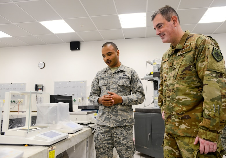 U.S. Air Force Brig. Gen. Mark R. August, 86th Airlift Wing commander, waits to see the literal weight of his signature during an immersion tour of the 86th Maintenance Group on Ramstein Air Base, Germany, Oct. 9, 2018. The 86th Maintenance Squadron Precision Measurement Equipment Laboratory Flight, which is the largest of the three PMEL flights in U.S. Air Forces in Europe, supports four combatant commands by calibrating equipment that requires quantitative measurements, some even as small as the weight difference a signature makes on a coaster. (U.S. Air Force photo by Staff Sgt. Timothy Moore)