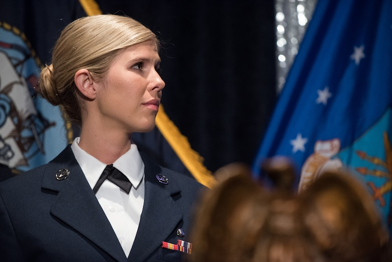 U.S. Air Force Senior Airman Linda M. Wilson, recipient of a 2018 Angel of the Battlefield award, stands onstage during the 2018 Armed Services YMCA Angels of the Battlefield Awards Gala in Arlington, Virginia, Oct. 2, 2018. Wilson risked her own life to save the lives of others during the deadly mass shooting at the Route 91 Harvest Festival in Las Vegas, Nevada on Oct. 1, 2017. Despite the danger, Wilson flagged down numerous cars to transport wounded victims, obtained first-aid supplies and utilized those supplies in treating victims. When she ran out of medical supplies, Wilson directed the use of clothing for improvised tourniquets, and then loaded eight critically injured victims into a car, providing lifesaving treatment throughout the trip to the hospital. (DoD photo by U.S. Army Sgt. James K. McCann)