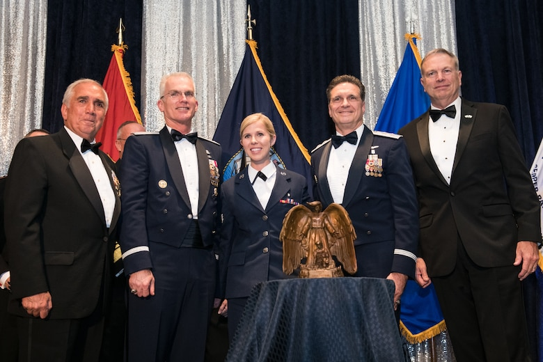 U.S. Air Force Senior Airman Linda M. Wilson (center) receives the Angel of the Battlefield award presented by Retired U.S. Army Gen. John Tilelli, Chairman of the Armed Services YMCA (far left), U.S. Air Force Gen. Paul J. Selva, Vice Chairman of the Joint Chiefs of Staff (second from left), U.S. Air Force Maj. Gen. (Dr.) Sean L. Murphy, Deputy Surgeon General of the U.S. Air Force (second from right), and Retired U.S. Navy Vice Adm. William D. French, President and Chief Executive Officer of the ASYMCA (far right), during the 2018 Armed Services YMCA Angels of the Battlefield Awards Gala in Arlington, Virginia, Oct. 2, 2018. Wilson risked her own life to save others during the deadly mass shooting at the Route 91 Harvest Festival in Las Vegas, Nevada on Oct. 1, 2017. Wilson flagged down numerous cars to transport wounded victims, obtained first-aid supplies to treat victims, directed the use of clothing for improvised tourniquets, and loaded eight critically injured victims into a car, providing lifesaving treatment en route to the hospital. (DoD photo by U.S. Army Sgt. James K. McCann)