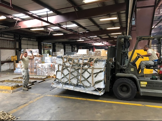 87th Aerial Port Squadron Airmen move a pallet during their annual tour while participating in Patriot Partner exercise with their Naval counterparts at Norfolk Naval Air Station's Navy Operated Air Mobility Command Terminal July 6-20, 2018.