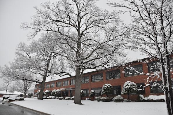 Archive photo of 459th Air Refueling Wing headquarters building covered in snow used in No Heat / No Cool story October 2018.