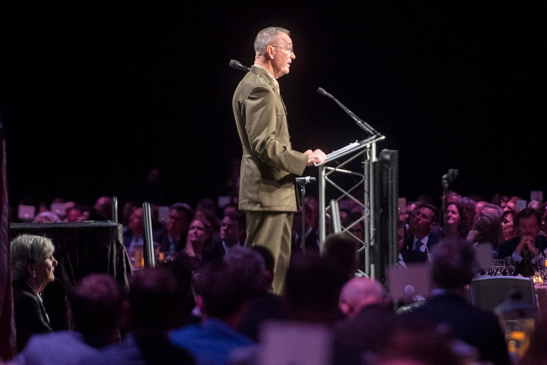 Marine Corps Gen. Joe Dunford stands behind a podium while making a speech.