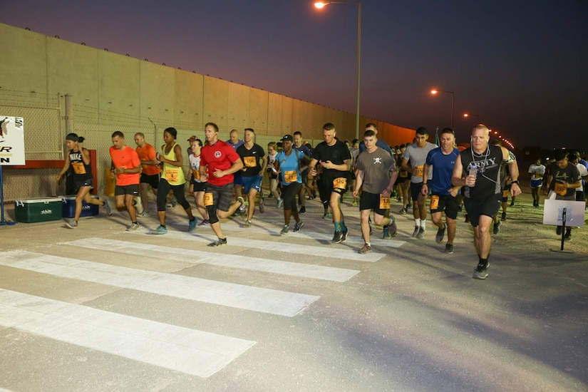 U.S. Army Soldiers at the start of the Army Ten-Miler at Camp As-Sayliyah, Qatar, October 7, 2018.  The race started early in the morning in order to try and avoid the scorching temperatures of the Qatari desert.