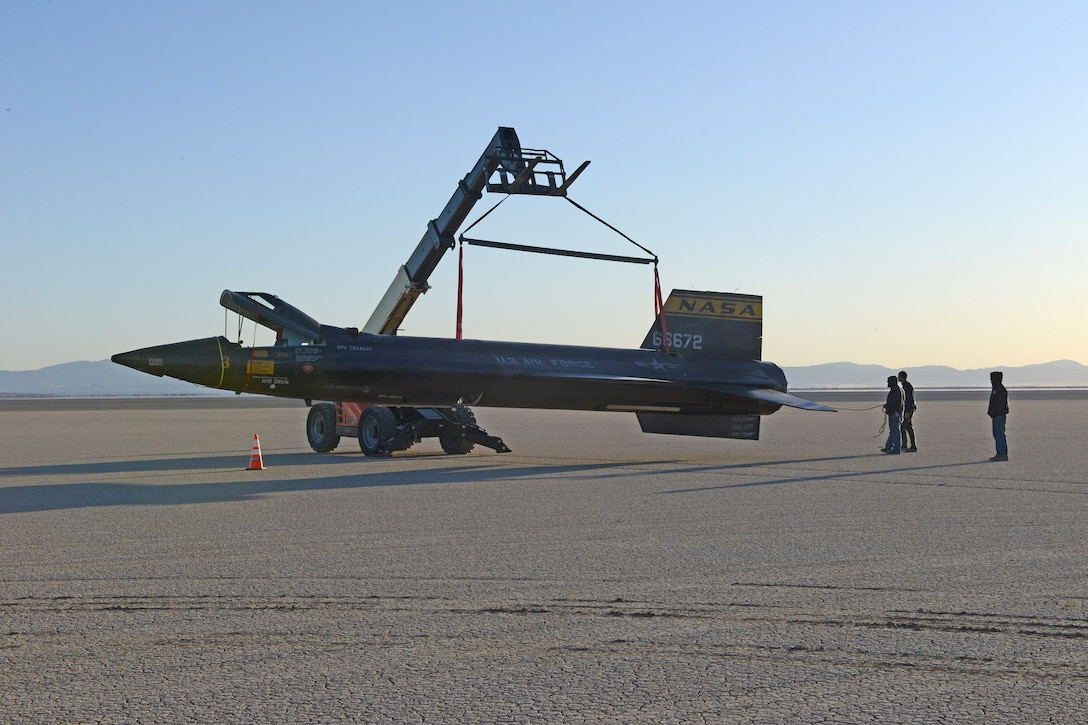 """A mockup of an X-15 rocket plane being placed on the lakebed at Edwards Air Force Base, Calif., Feb. 21, 2018, for a scene in the film """"First Man."""" The Air Force Public Affairs Entertainment Liaison office partnered with creators to project and protect the image of the U.S. Air Force within the global entertainment environment. (U.S. Air Force photos by Kenji Thuloweit)"""