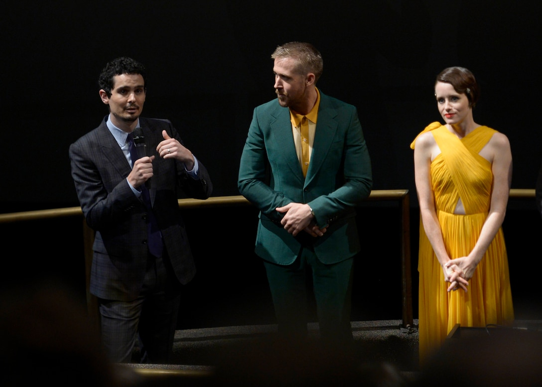 """Damien Chazelle, director and producer of """"First Man, Ryan Gosling, actor, and Claire Foy, actress, speak to an audience of Airmen and civilian attendees during the premiere of the film """"First Man"""" at the Smithsonian National Air and Space Museum, Washington, D.C., Oct. 4, 2018. The film, based on a book by Jim Hansen, chronicles the life of NASA astronaut Neil Armstrong from his time as an X-15 test pilot through the moon landing in 1969. (U.S. Air Force photo by Staff Sgt. Victoria H. Taylor)"""