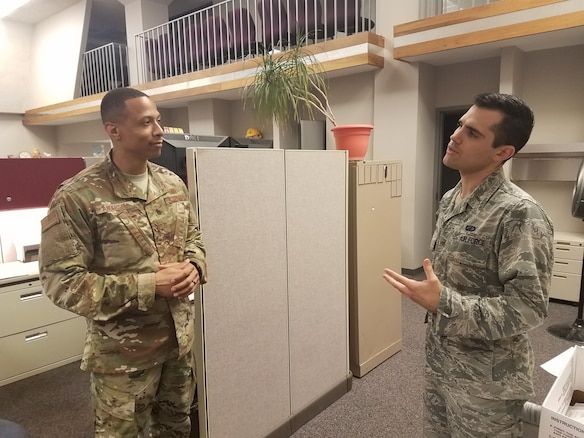 2nd Lt. Evan Ewing (right), contracting specialist with the Air Force Life Cycle Management Center's Installation Contracting Division, discusses policy with 2nd. Lt. Thomas Anderson, also a contracting specialist with the division.