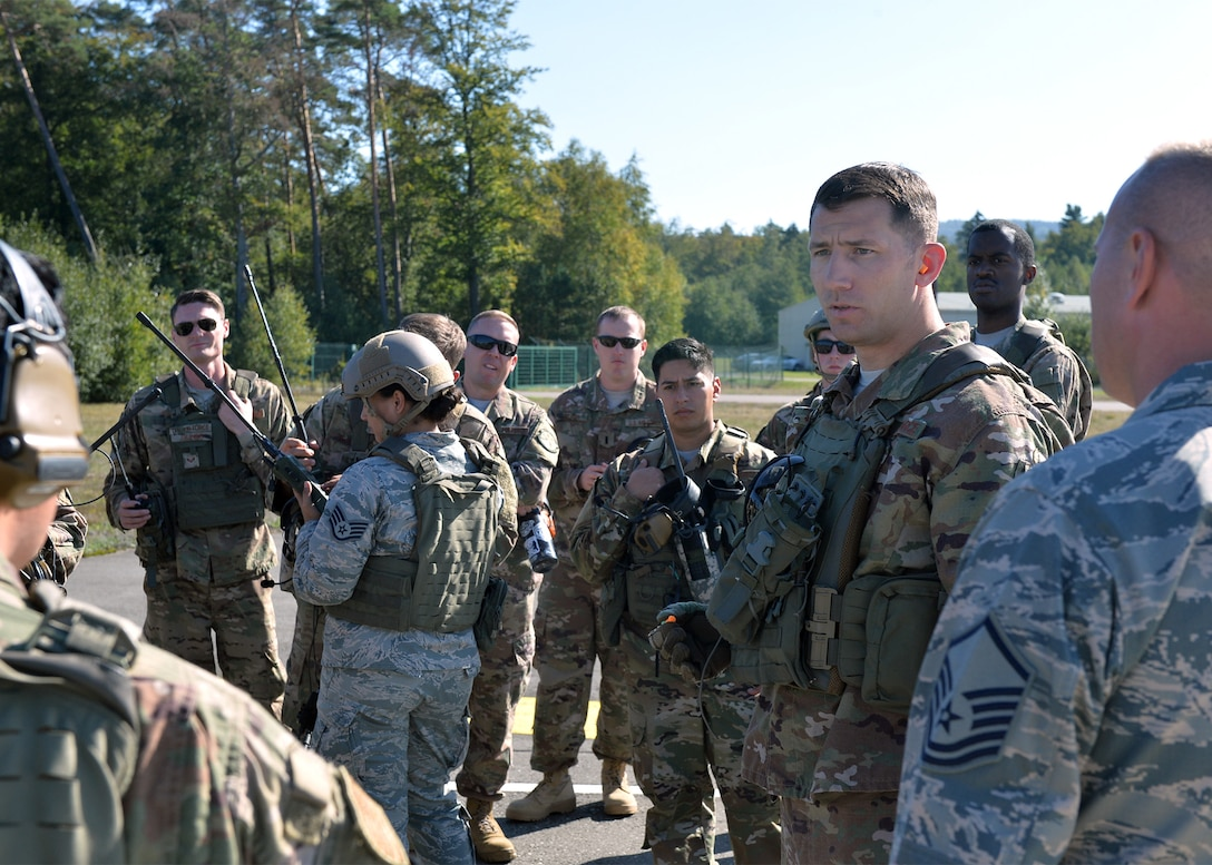 """U.S. Air Force Tech. Sgt. Jayson Lyons, 435 Contingency Response Squadron operations, readiness, and training flight chief, briefs Airmen on operations and safety for exercise Temperate Ace on Ramstein Air Base, Germany, Oct. 4, 2018. During the exercise, Airmen performed a """"hot refuel"""" where an aircraft is refueled while the engines run to demonstrate the ability to support strike packages with the least amount of equipment and personnel. (U.S. Air Force photo by Staff Sgt. Jimmie D. Pike)"""