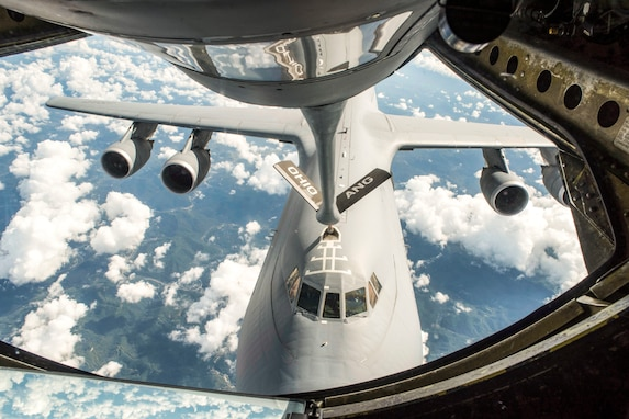 A KC-135 Stratotanker with the 121st Air Refueling Wing, Ohio refuels a C-5 Galaxy with the 436th Airlift Wing at Dover Air Force Base, Del., in the sky over the southeastern United States October 3, 2018. U.S. Air National Guard photo by Airman 1st Class Tiffany A. Emery)